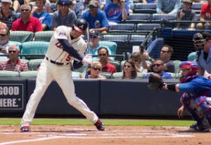 Freddie Freeman swinging a bat.